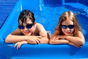 Kids in the pool with sunglasses