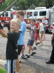 Children wearing safety glasses while participating in hands-on activities.