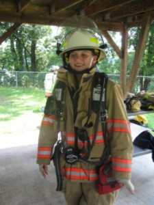Wearing firefighter gear