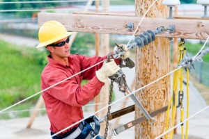 Line worker wearing dielectric safety glasses
