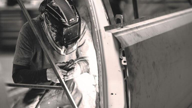 Welder Using Auto-Darkening Helmet
