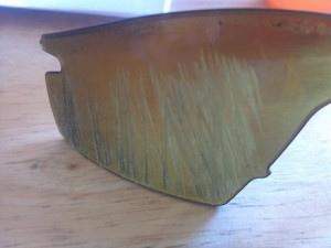 Oakley M-Frame lenses scratched from impact with pavement.