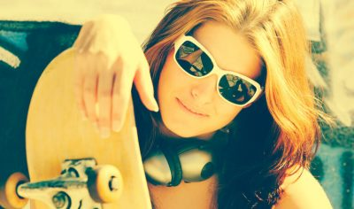 Female Skateboarder In Sunglasses