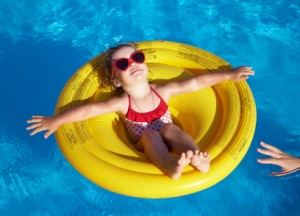 Girl floating in pool