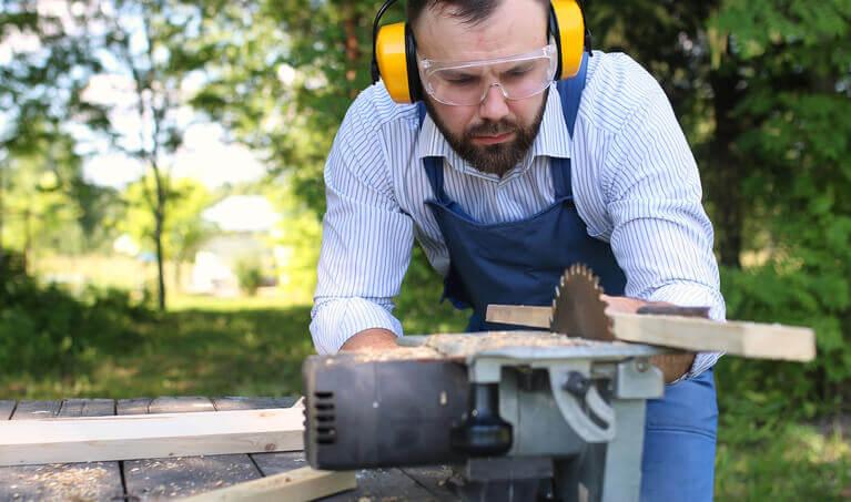 Man Working On Circular Saw