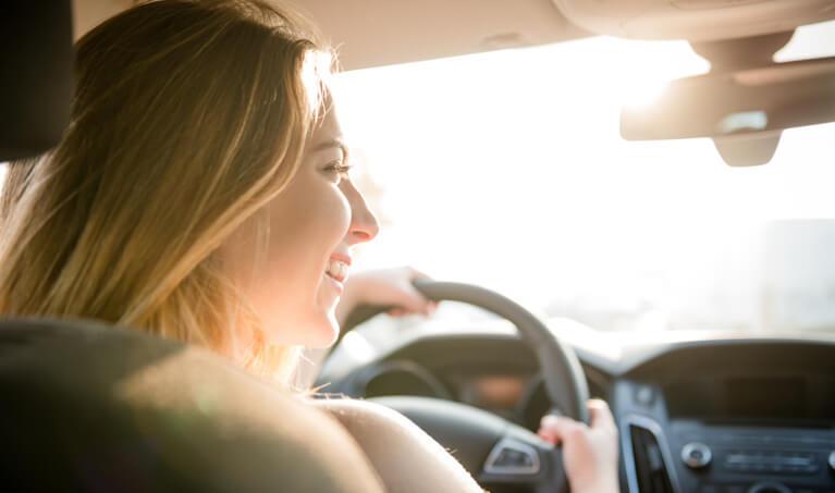 Girl Driving Sun