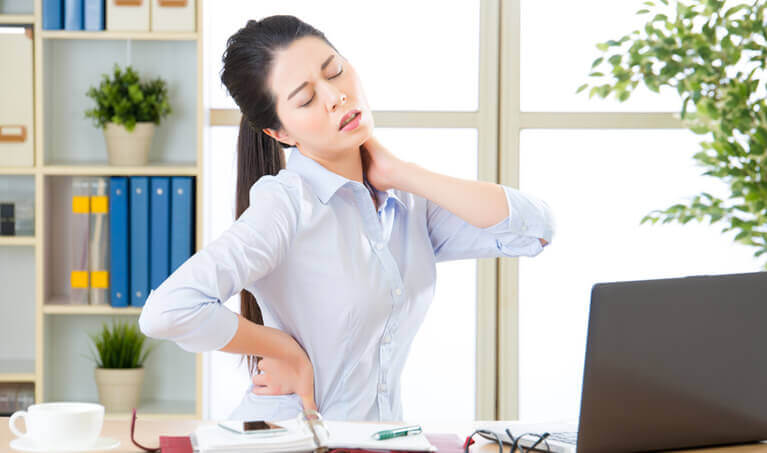 Woman At Computer With Sore Neck