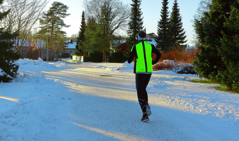 Man Jogging In Reflective Vest