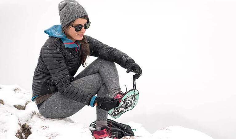 Woman Putting Yaktrax On