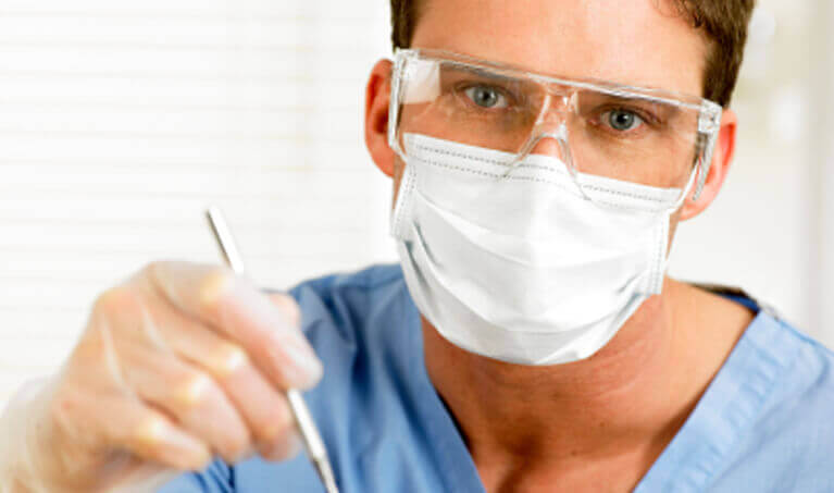 Dentist Wearing Mask and Safety Eyewear