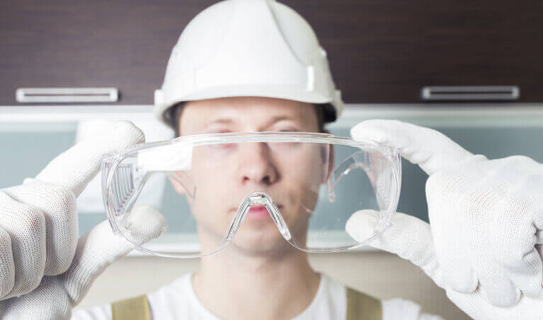 Man Holding Over-The-Glass Safety Glasses