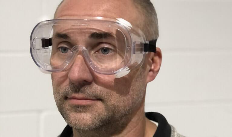 Man Wearing Splash Goggles